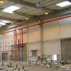 NOZ2 air heater installed in high-ceilinged halls.